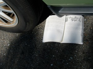 Tire tracks on book after being run over