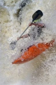 Kayak maneuvering turbulent water